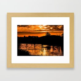 Silhouetted Canadian Geese taking a break in a pond in Ann Arbor, Michigan Framed Art Print