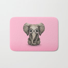 Cute Baby Elephant Calf with Reading Glasses on Pink Bath Mat