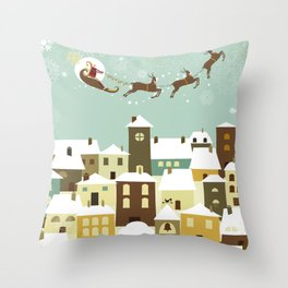 Santa flying in his sleigh over a village Throw Pillow