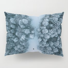 Man lying in the snow on a frozen lake in a winter forest - Landscape Photography Pillow Sham