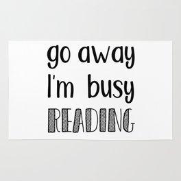 Go away, I'm busy reading! Rug