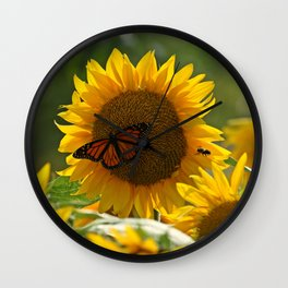 The butterfly the bee and the sunflower Wall Clock