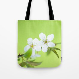 Cherry blossom tree in the green Tote Bag