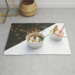 Two cups of ice cream for dessert Rug