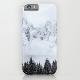 Snowy mountains and spruce forest iPhone Case