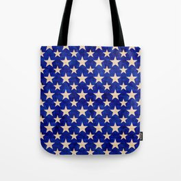 Gold stars on a dark blue background. Tote Bag