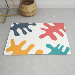 Four colored leaves Rug