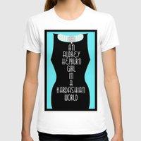 kardashian T-shirts featuring An Audrey Hepburn girl in a Kardashian world (in blue) by Miss Golightly