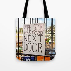 Pipe store next door Tote Bag