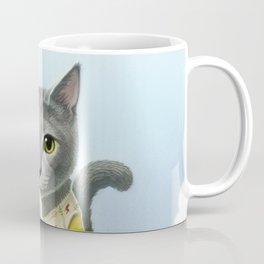 A cat sitting in the flower garden Coffee Mug