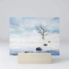 zen concept with beautiful sea level with fantasy sky and stone, dead tree Mini Art Print