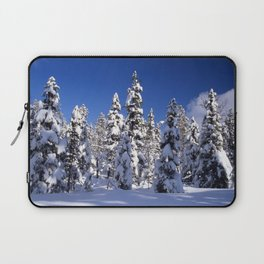 Snow covered trees in the forest. Winter day with blue sky. Laptop Sleeve