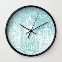 aelwen Wall Clocks featuring Hang in there.  by Elena O'Neill