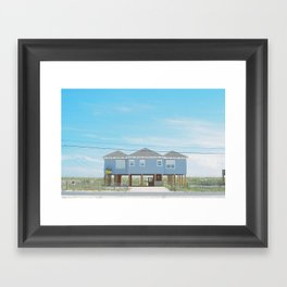 Blue Beach House Against A Blue Sky Framed Art Print