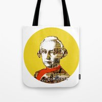 mozart Tote Bags featuring Mozart Kugel Yellow by Marko Köppe