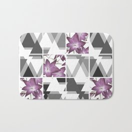 Pink lilies on a cramped gray background triangles . Bath Mat