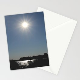 Silhouettes of two people on a rubber boat in a sunny reflection Stationery Cards