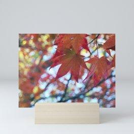 red maple leaves and bokeh Mini Art Print