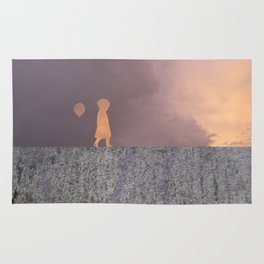 Sunset with girl walking on a wall followed by a balloon Rug