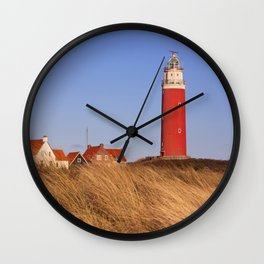 Lighthouse on Texel island in The Netherlands in morning light Wall Clock