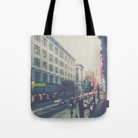 broadway Tote Bags featuring Broadway Street by Story Of Tascha