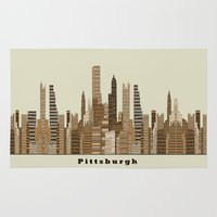pittsburgh Area & Throw Rugs featuring Pittsburgh skyline vintage by bri.buckley