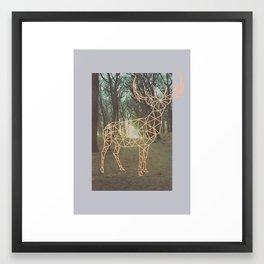 A rendeer beyond the pines Framed Art Print