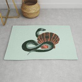 Black snake and coral seashell Rug