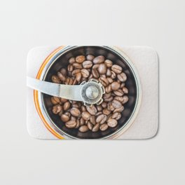 Roasted coffee beans in a manual coffee grinder. The view from the top. Bath Mat
