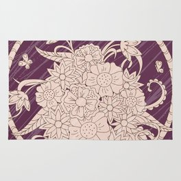 bouquet of the flowers on the violet grunge background Rug