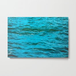 Colorful blue water with small waves Metal Print