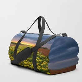 Yellow Flower Road - Path of Wildflowers Lead Into Texas Sunset on Stormy Evening Duffle Bag