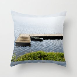 boat moored to old wood boardwalk Throw Pillow