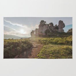 Megalith at sunset Rug