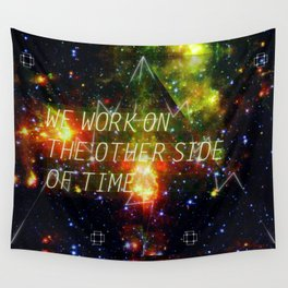 we work on the other side of time. Wall Tapestry