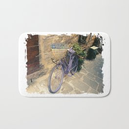 Vintage  bicycle with wicker basket at the street. Bath Mat