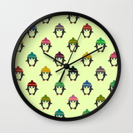 Penguins with colorful beanies Wall Clock