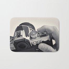 Retro SLR camera in hands photographer Bath Mat