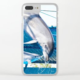 Dolphins jumping out of water on show Clear iPhone Case