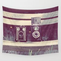 cameras Wall Tapestries featuring two cameras sitting on a park bench ...  by Laura Evans