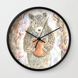A bear bearing a pumpkin Wall Clock