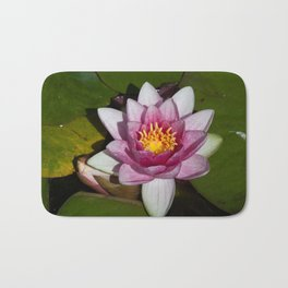 Water Lily with lily Pads, floating in a lake Bath Mat
