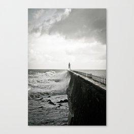 Waves break against an English pier Canvas Print