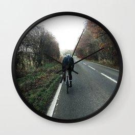hammering down on road bike Wall Clock