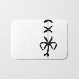 Laced Black Ribbon on White Bath Mat