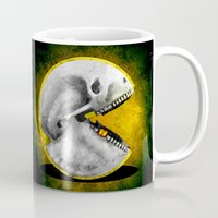 pacman Mugs featuring Skull Pacman by Diego Tirigall