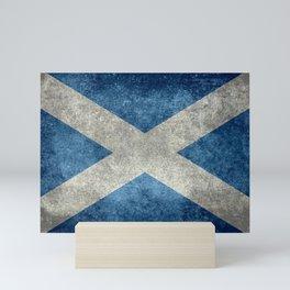 Flag of Scotland in grungy textures Mini Art Print