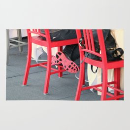 Sitting Cross Legged On The Red Chair Rug