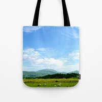 scotland Tote Bags featuring Highlands Scotland by seb mcnulty