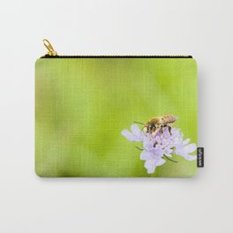 A bee on a flower Carry-All Pouch